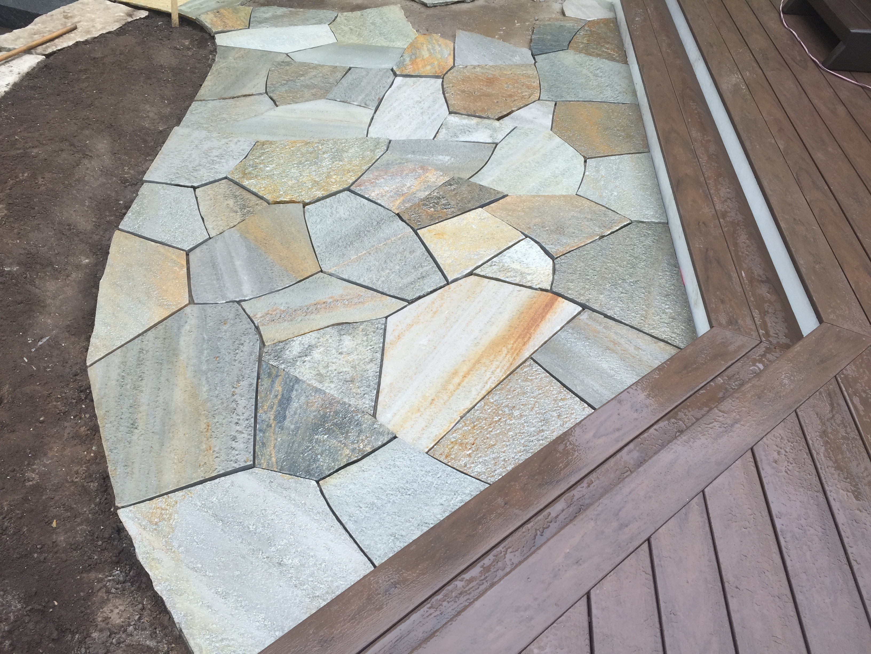 beautiful stone work at edge of wood deck