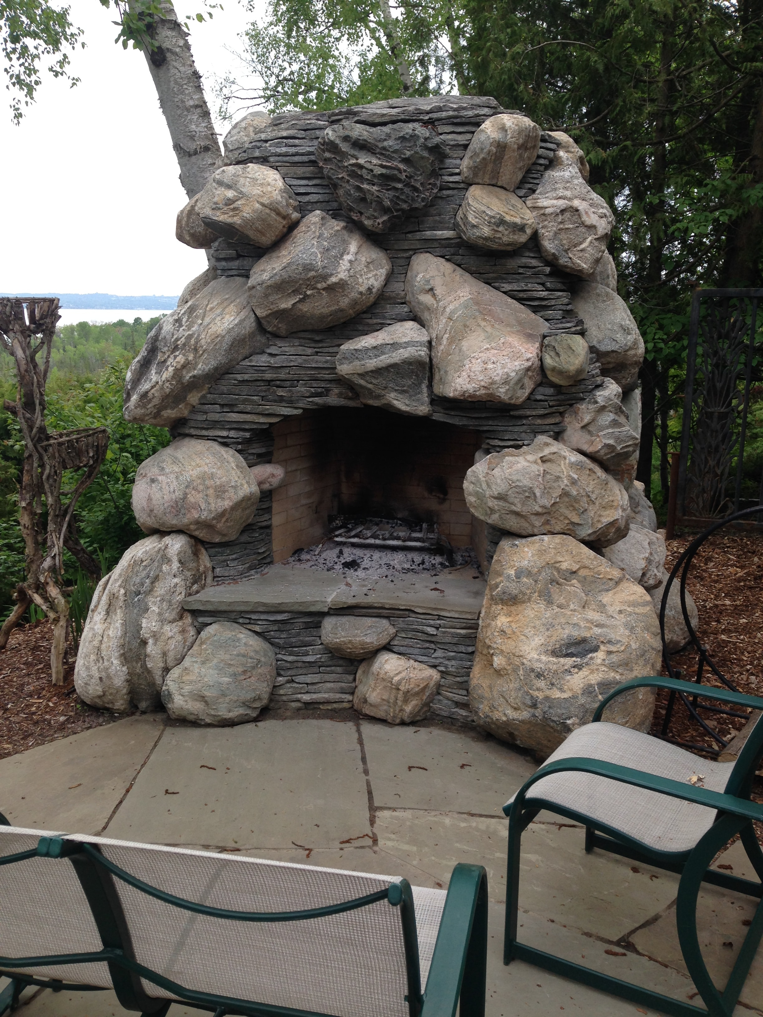 outdoor masonry fireplace using large stones