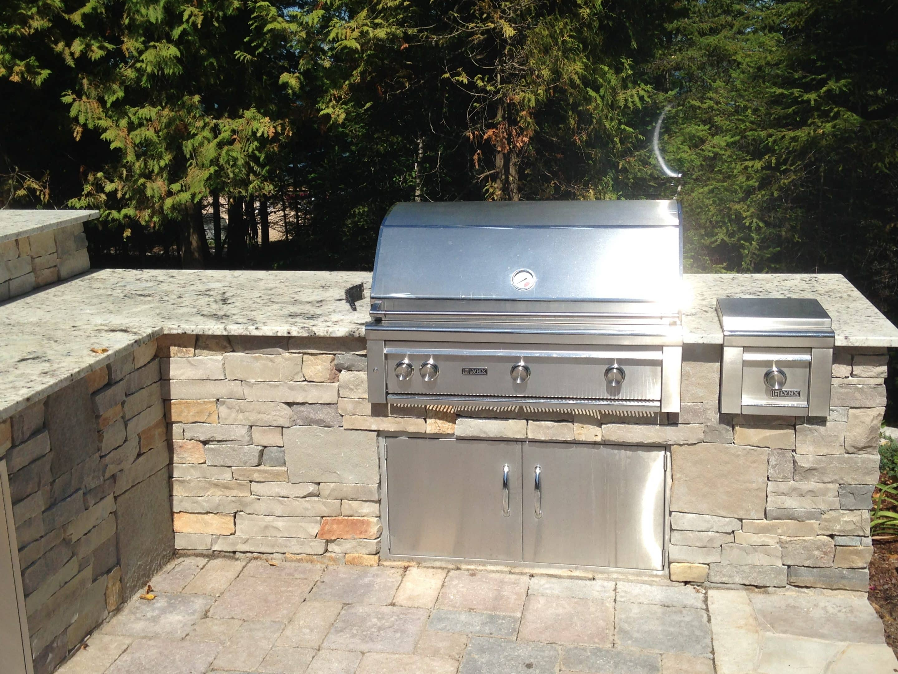 completed outdoor kitchen including grill installation