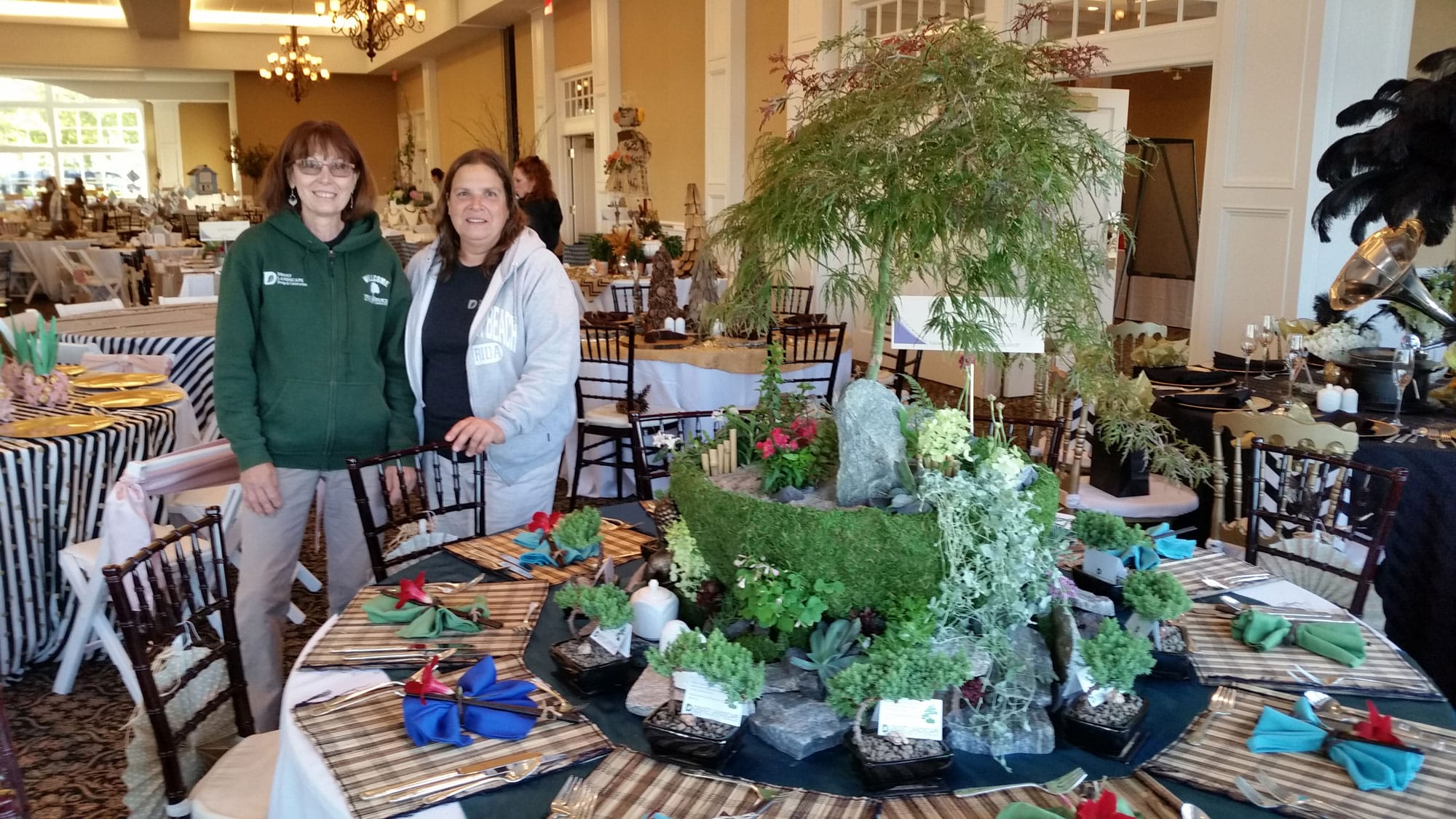 community involvement photo - arbor arrangement centerpiece and table setting