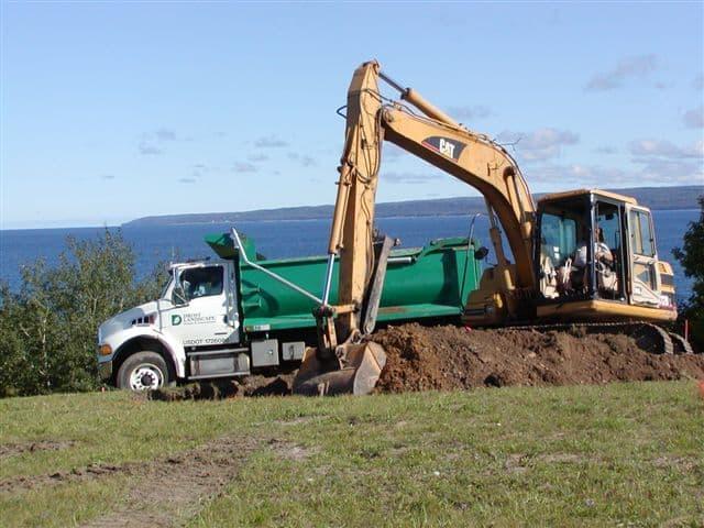 Drost Landscape excavator and dump truck working hard