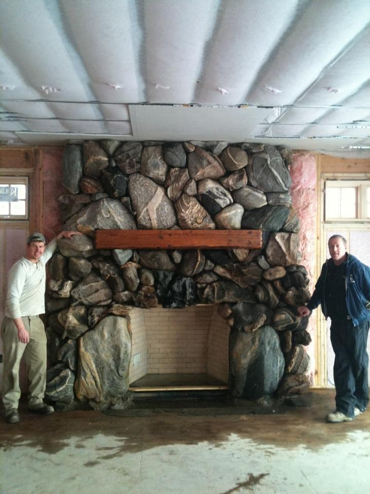 beautiful one of a kind stone fireplace installation