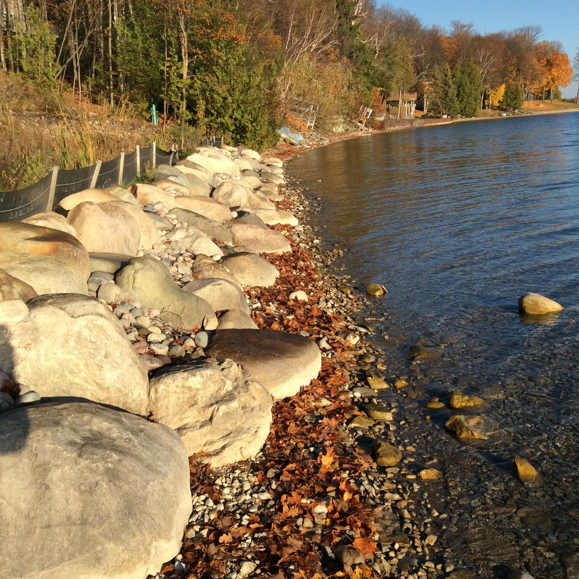 lake shore landscape installation prevents erosion and looks goreous