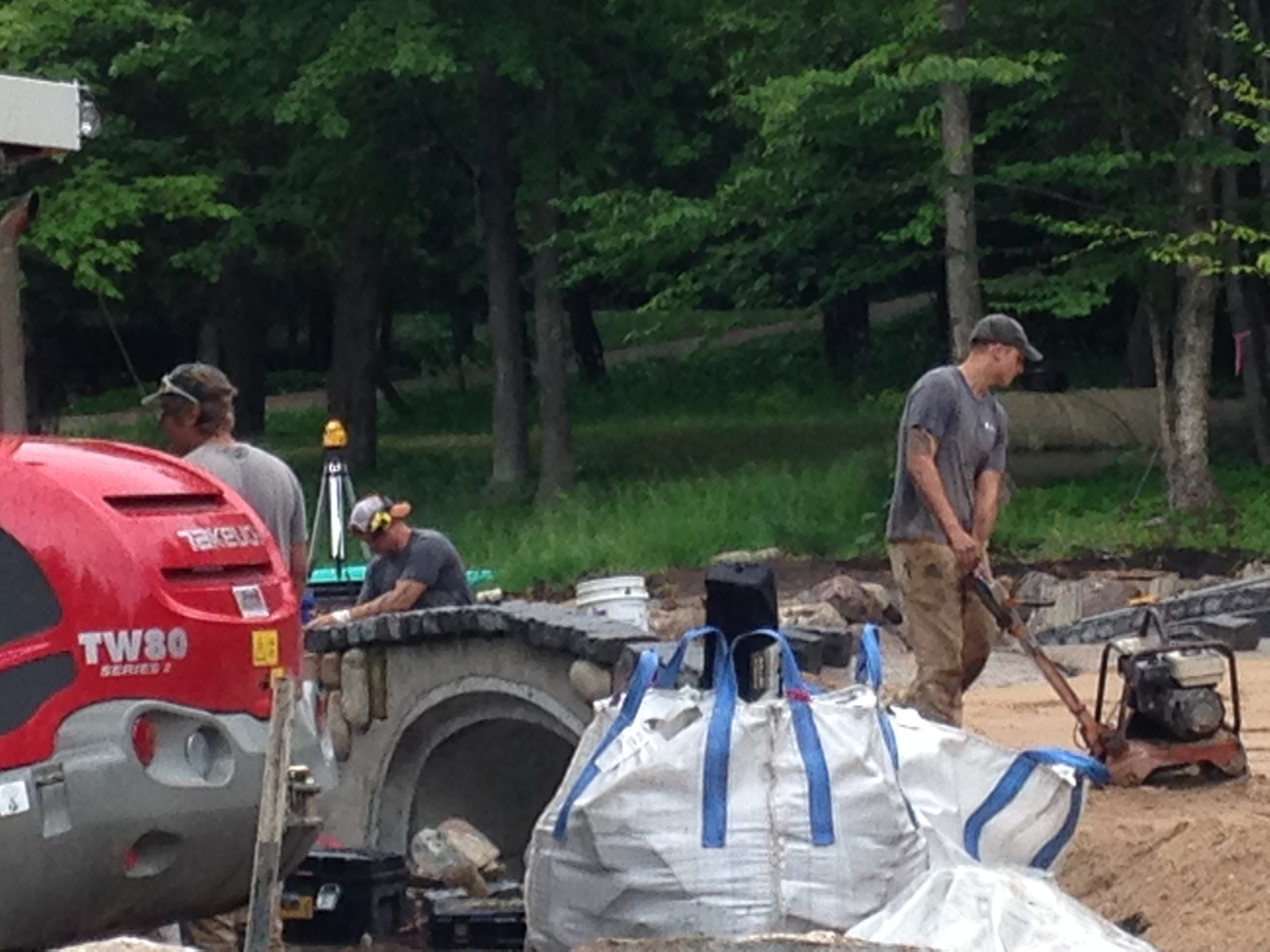 building a driveway bridge over a water feature - functional and strikingly beautiful