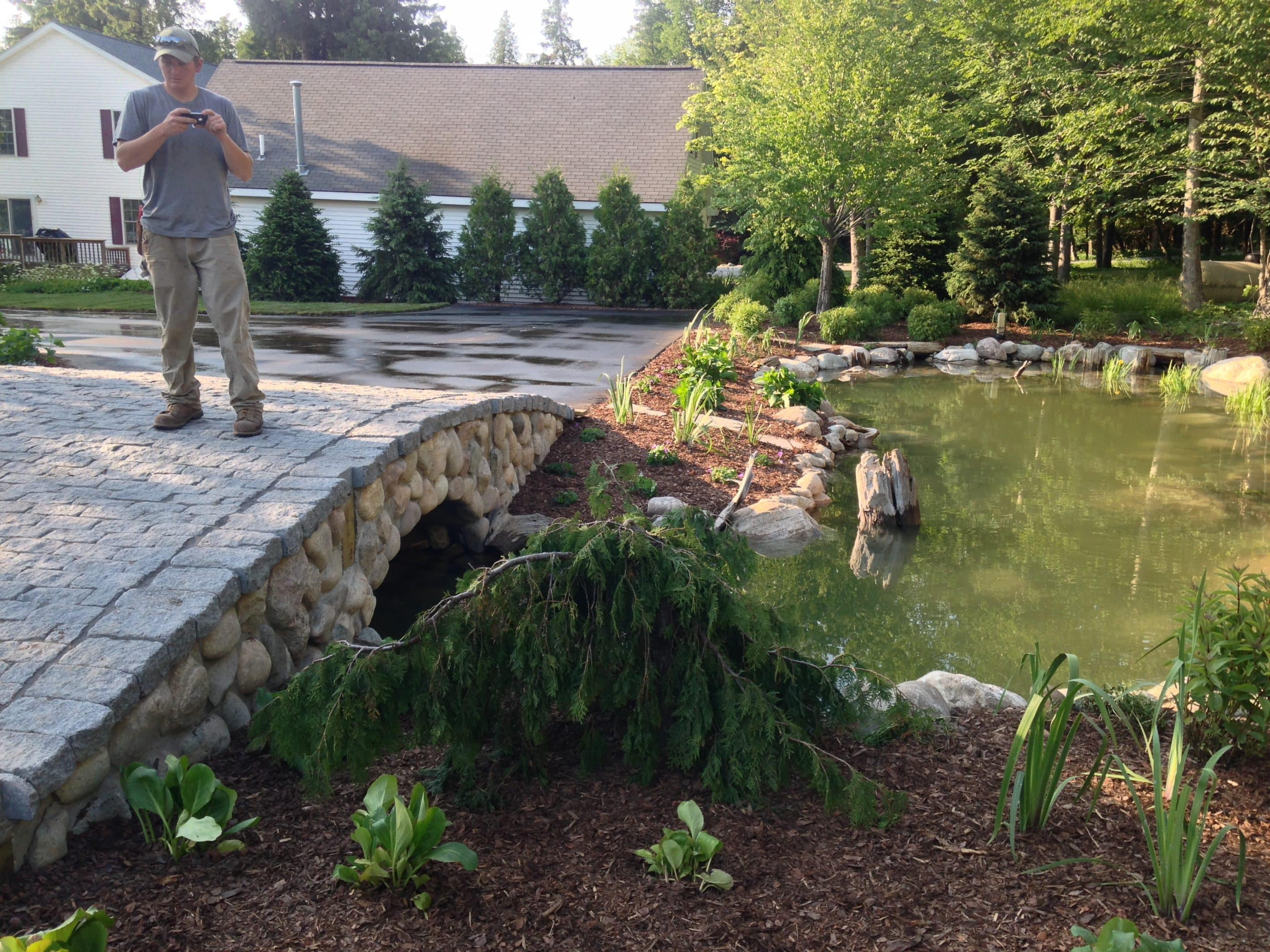 water feature installation completed including a driveway bridge
