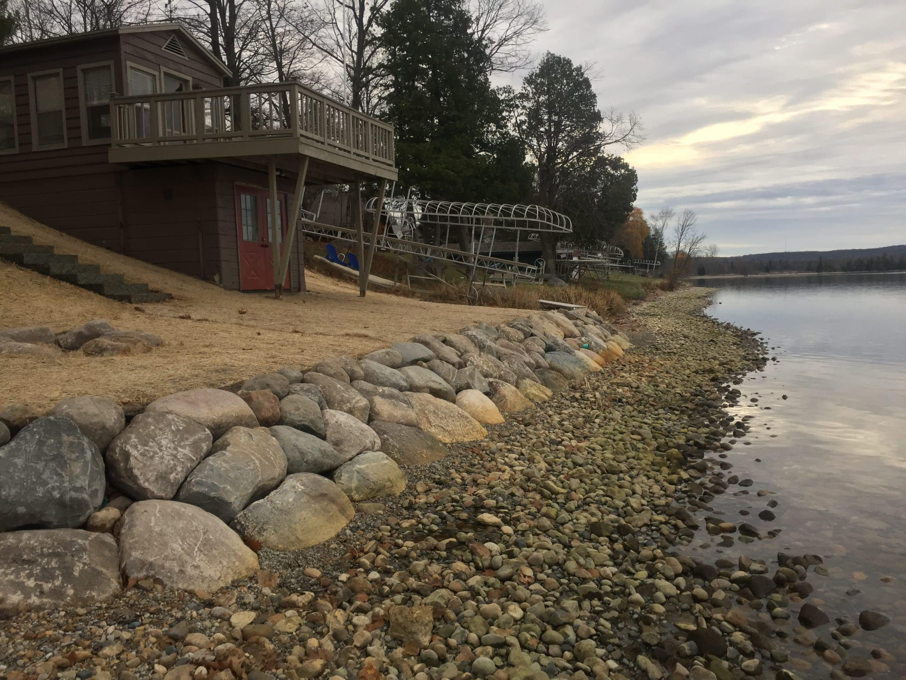 lake front landscape installation prevents erosion and adds enjoyment in a strikingly beautiful way