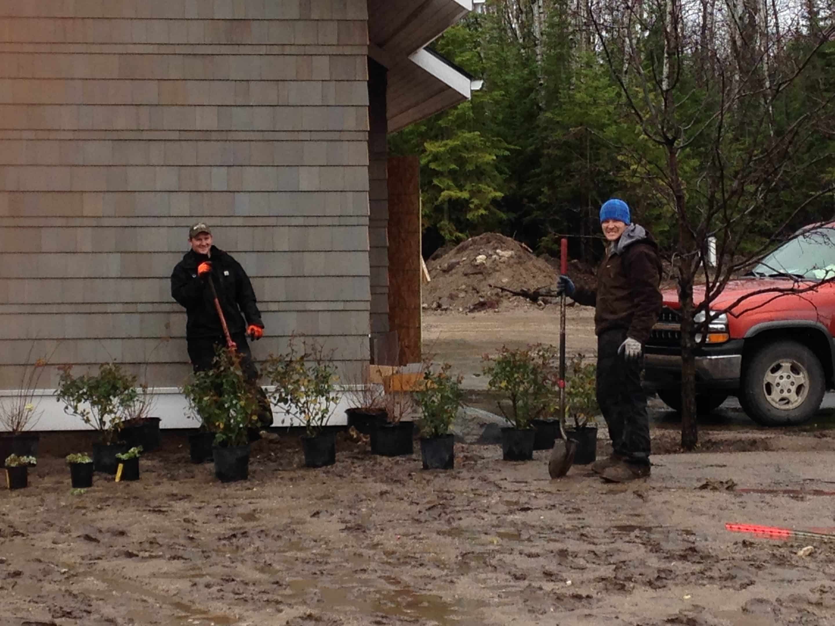 Drost Landscape works hard, rain or shine - cold and rainy here