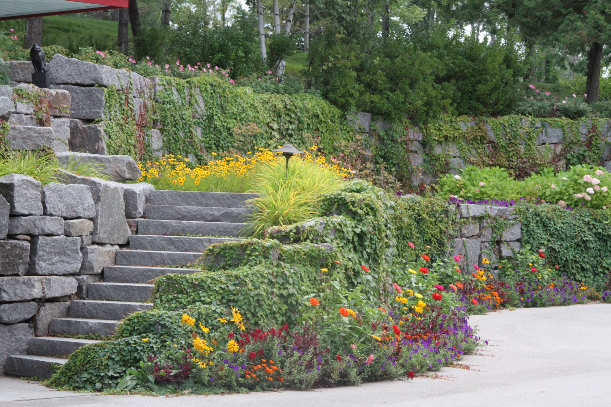 floral and vine coverage for beautiful stone steps and stone retaining walls
