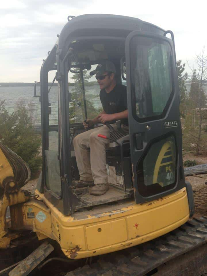 in the excavator cab by the lake shoreline