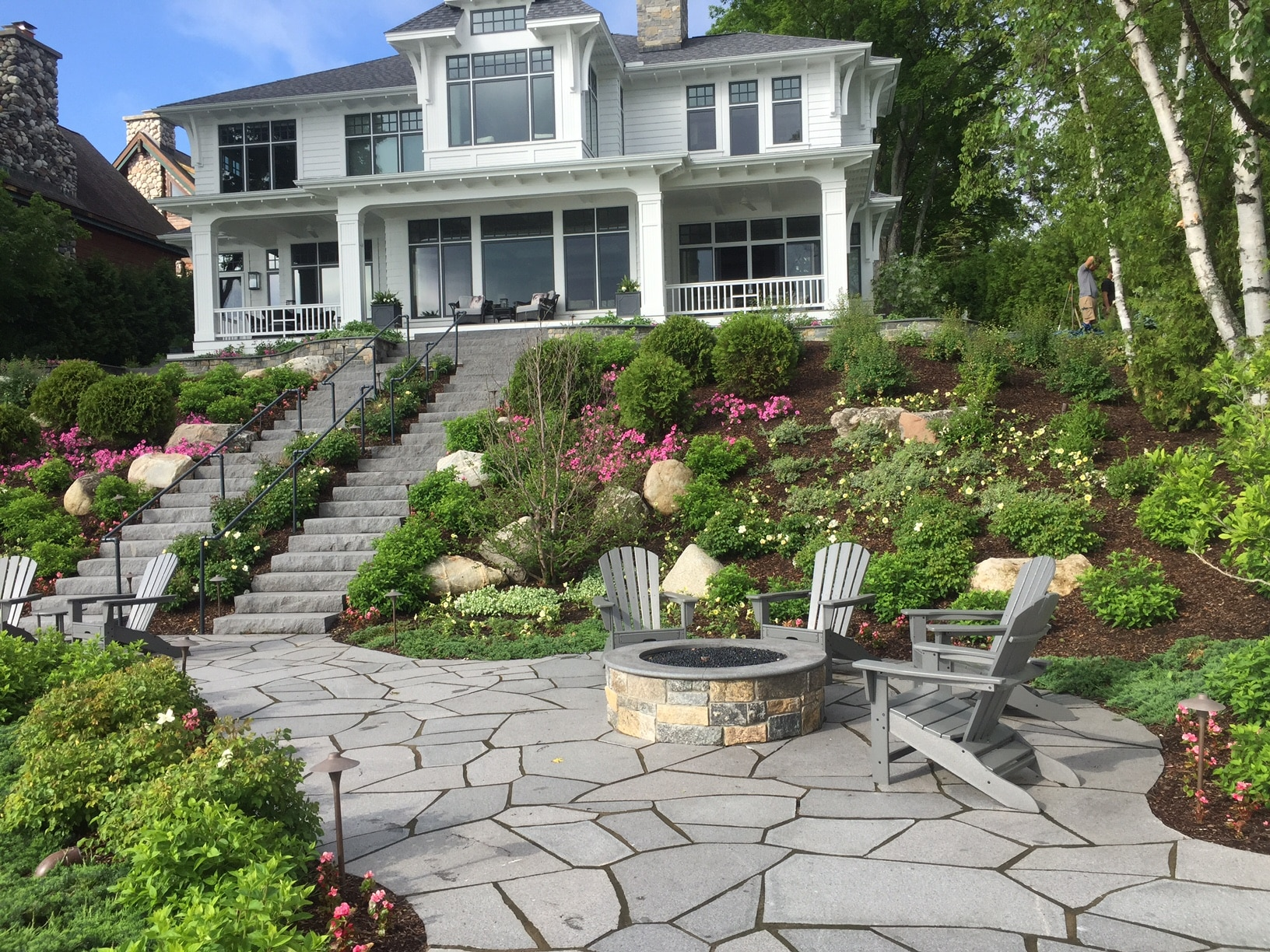 stone steps, walkway and patio provide masonry fire pits like this beauty and functionality. Framed by just the right design of beautiful plants and mulch. Designed for years of enjoyment