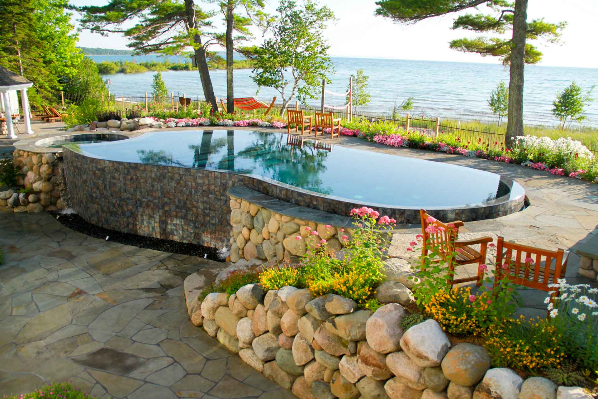 rock wall pool landscape